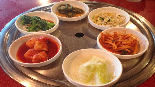 Clockwise: Jalapeño, bean sprouts, raddish Kimchi, cabbage, cubed raddish Kimchi, and broccoli.