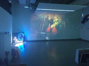One art show features projected videos and shadows.