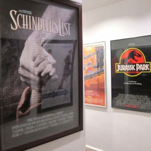 The hallway towards the restroom filled with posters of Spielberg's movies