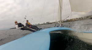 """Two sailors trapezing off of a P-Cat, a 19ft """"Pacific Catamaran"""" in Redondo Beach."""