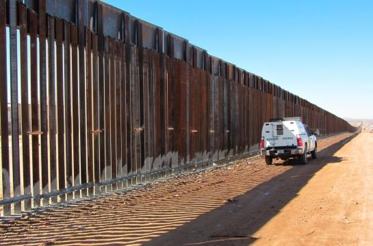 The border fence that already exists around some border cities near Mexico. Photo courtesy of http://www.latitudenews.com