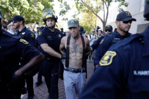 "A demonstrator is arrested during a free speech rally Sunday, Aug. 27, 2017, in Berkeley, Calif. Several thousand people converged in Berkeley Sunday for a ""Rally Against Hate"" in response to a planned right-wing protest that raised concerns of violence and triggered a massive police presence. Several people were arrested for violating rules against covering their faces or carrying items banned by authorities. (AP Photo/Marcio Jose Sanchez)"